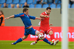 REYKJAVIK, ICELAND - Wednesday, May 28, 2008: Wales' Joe Ledley crosses for the opening goal aginst Iceland during the international friendly match at the Laugardalsvollur Stadium. (Photo by David Rawcliffe/Propaganda)