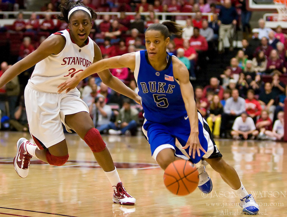 December 15, 2009; Stanford, CA, USA;  Duke Blue Devils guard Jasmine Thomas (5) dribbles past Stanford Cardinal forward Nnemkadi Ogwumike (30) during the first half at Maples Pavilion.