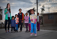AREQUIPA, PERU - APRIL 4, 2014: Kids jumping rope and having fun with in the community of Flora Tristan with volunteers from HOOP Peru. HOOP Peru is a NGO fully committed to breaking the cycle of poverty by empowering the Flora Tristan families through enhancing their education.