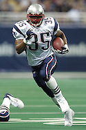 New England Patriots running back Patrick Pass rushes for first down yardage against the St. Louis Rams, early in the first quarter of the Patriots 40-22 win at the Edward Jones Dome in St. Louis Missouri, November 7, 2004.