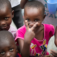 Children play around after the Sunday chapel service at the Heal Africa hospital in Goma, Congo.