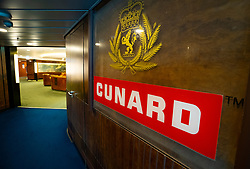 Cunard sign at entrance to First Class deck of Queen Elizabeth 2 former ocean liner now reopened as hotel in Dubai , United Arab Emirates