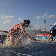 High School students in action during the Steeplechase competition at the 2013 NYC Mayor's Cup Outdoor Track and Field Championships at Icahn Stadium, Randall's Island, New York USA.13th April 2013 Photo Tim Clayton