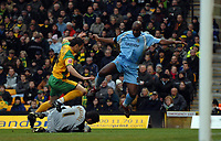 Photo: Ashley Pickering/Sportsbeat Images.<br /> Norwich City v Coventry City. Coca Cola Championship. 24/11/2007.<br /> Dele Adebola of Coventry (R) challenges Norwich goalie David Marshall