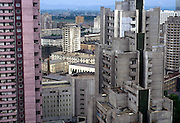 Pyongyang's city centre is characterised by bland apartment buildings, where electricity is rationed to one light bulb until 9pm, after which blackness ensues. Featureless, dour and grey apartment buildings of the North Korean capital.