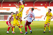 Liam Kinsella of Walsall headers the ball during the EFL Sky Bet League 2 match between Stevenage and Walsall at the Lamex Stadium, Stevenage, England on 20 February 2021.