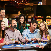 Photoshoot at casino table with couples playing in California