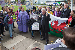 London, UK. 5 November, 2019. Hugh Gaffney, Scottish Labour MP for Coatbridge, Chryston and Bellshill, addresses campaigners from WASPI (Women Against State Pension Inequality) protesting in Parliament Square to call for fair transitional pension arrangements for women born in the 1950s affected by the changes to the State Pension Age (SPA), including a 'bridging' pension to provide an income from age 60 until State Pension Age and recompense for losses incurred by women who have already reached their SPA.