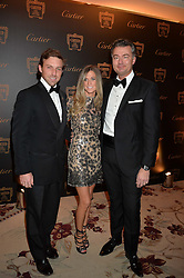 MR & MRS CHARLIE LANGTON and LAURENT FENIOU at the 26th Cartier Racing Awards held at The Dorchester, Park Lane, London on 8th November 2016.
