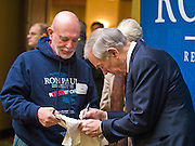 22 FEBRUARY 2012 - MESA, AZ:  Congressman RON PAUL greets supporters and signs autographs during a fundraiser in Mesa, AZ, Wednesday. Congressman Paul is participating in the CNN debate in Mesa, AZ, later Wednesday night. He has several fundraisers scheduled in Mesa before the debate.    PHOTO BY JACK KURTZ
