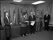 """Irish Laureate Women Of Europe Award. (T10)..1989..17.11.1989..11.17.1989..17th November 1989..Speculation regarding the Irish Laureate for the 1989 Women of Europe Award ended today when the Minister for Education, Ms Mary O'Rourke TD, announced that the Irish Laureate for this year is Grainne Kenny. Founder member of EURAD (Europe Against Drugs), and well known for her work as """"The drugs lady"""" in Ireland, Grainne Kenny has been involved in the fight against drugs since 1980. She helped form CAD, Community Action and Drugs and later EURAD. EURAD is has the active co-operation of both the European Commission and Parliament...Image shows the Minister for Education, Mary O'Rourke (left) preparing for the presentation with members of the organising committee. Ms Mary Robinson is pictured to her right."""