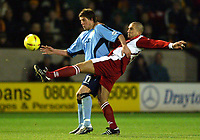 Photograph: Scott Heavey.<br />Walsall v Bradord City. Nationwide Division One. 06/12/2003.<br />Andy Gray (L) and Paul Ritchie battle for the ball
