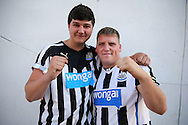 two Newcastle United fans pose outside Loftus Road before k/o. EFL Skybet football league championship match, Queens Park Rangers v Newcastle Utd at Loftus Road Stadium in London on Tuesday 13th September 2016.<br /> pic by John Patrick Fletcher, Andrew Orchard sports photography.