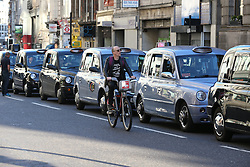 © Licensed to London News Pictures. 30/09/2015. London, UK. Black cabs block The Strand and Fleet Street in protest over the Uber taxi app. Photo credit: Peter Macdiarmid/LNP
