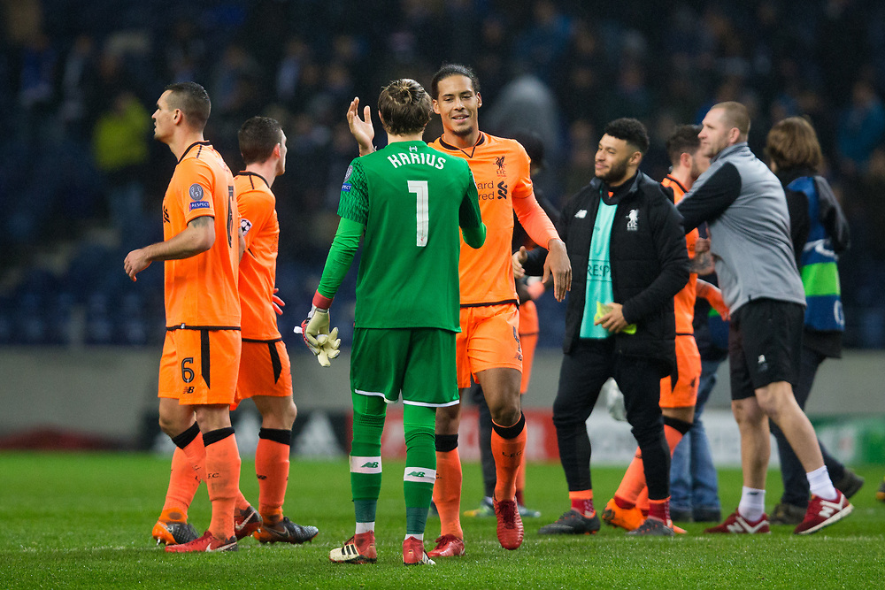 Liverpool's Virgil van Dijk celebrates with team mate Loris Karius at full time <br /> <br /> Photographer Craig Mercer/CameraSport<br /> <br /> UEFA Champions League Round of 16 First Leg - FC Porto v Liverpool - Wednesday 14th February 201 - Estadio do Dragao - Porto<br />  <br /> World Copyright © 2018 CameraSport. All rights reserved. 43 Linden Ave. Countesthorpe. Leicester. England. LE8 5PG - Tel: +44 (0) 116 277 4147 - admin@camerasport.com - www.camerasport.com