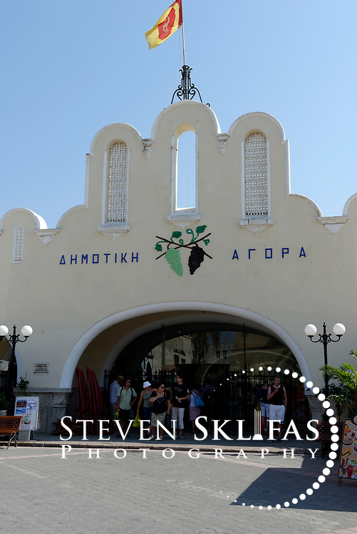 View of the façade of the Market Hall at Eleftherias Square in Kos town the capital of the Greek island of Kos The market was built by the Italians in 1934 and sells fruit, vegetables, culinary and souvenirs. Kos is part of the Dodecanese island group and birthplace of the ancient physician and father of medicine, Hippocrates. Please contact Steven Sklifas for more information.
