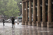 France, Paris, Walking past the Comodie Fracaise in the rain. 1st arrondissemnt