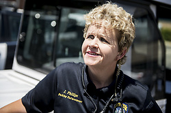 May 9, 2017 - Merced parking enforcement officer, Jessica Phillips, 50, of Los Banos, speaks about how she stopped to help save a man's life last week, at the Merced police station in Merced, Calif., on Tuesday, May 9, 2017. According to Phillips, she was driving her parking enforcement scooter south on G Street when she was flagged down by a bystander south of Alexander Avenue on Friday, May 5. She was alerted to a 78-year-old man who had collapsed on the sidewalk near the Bear Creek Village shopping center. Phillips said she checked the man to see if he was alive and used her radio to call for an ambulance. Merced police officer Krista Stokes heard the call and drove to the scene where she administered cardiopulmonary resuscitation to the man before an ambulance arrived. The man is recovering at Emanuel Medical Center in Turlock. (Credit Image: © Andrew Kuhn/The Merced Sun Star via ZUMA)