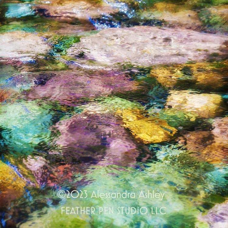 Jewel-toned rocks of western Montana, sparkling in sumlight.  Rattlesnake Creek, Missoula.