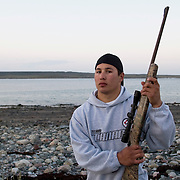 Jordin Tootoo grew up in a small village along the Hudson Bay only a hundred miles from the Arctic Circle. The first Inuit to play professionally in the National Hockey League, Tootoo is close to his family and friends to nearly everyone in Rankins Inlet in Northeast Canada. During the off season, Jordin spends time fishing and hunting with his family. Like nearly everyone in Rankins Inlet, living off the land is a way of life. <br /> <br /> Image available for licensing and for a personal print. Please Add To Cart and select the size and finish. All prints are delivered directly to you from the printer.
