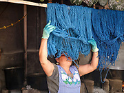 Master Dyer Juana Gutierrez Contreras hanging out wool dyed with indigo in the Zapotec weaving village of Teotitlan del Valle in Oaxaca, Mexico on 29 November 2018