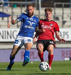 Emil Nielsen (Lyngby Boldklub) og Pep Biel (FC København) under kampen i 3F Superligaen mellem Lyngby Boldklub og FC København den 1. juni 2020 på Lyngby Stadion (Foto: Claus Birch).