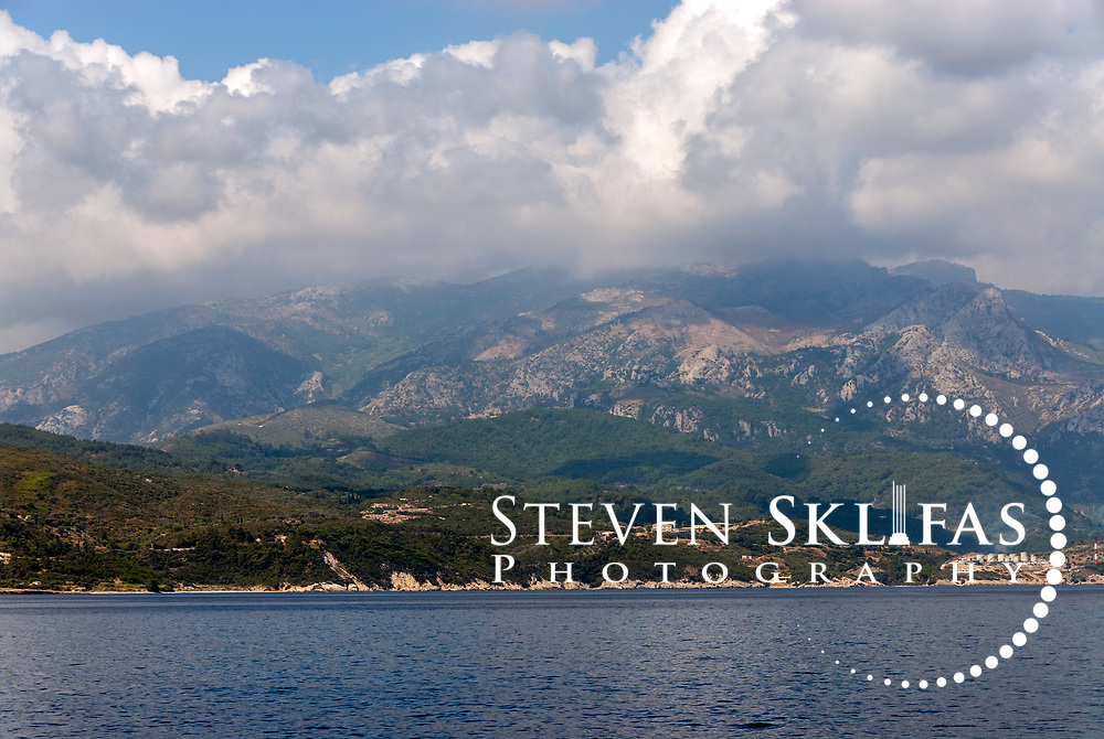 Samos. Greece. View from a ferry of the rugged mountainous North coast of Samos near the town of Kokkari.