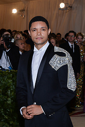 Trevor Noah walking the red carpet at The Metropolitan Museum of Art Costume Institute Benefit celebrating the opening of Heavenly Bodies : Fashion and the Catholic Imagination held at The Metropolitan Museum of Art  in New York, NY, on May 7, 2018. (Photo by Anthony Behar/Sipa USA)