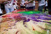 Colors blend together on a table outside Younker Hall during the Holi celebration at Grinnell College on Saturday.<br /> BEN BREWER/Grinnell College