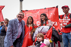 © Licensed to London News Pictures. 12/05/2018. LONDON, UK. (L to R)  Len McLuskey, General secretary of Unite, Jaya Hackett (aged 10, Kira Hacket (aged 13) and Eliza May Hacket (aged 2) pose for a phot as thousands of people take part in a Trades Union Congress (TUC) march and rally, from Embankment to Hyde Park, calling for improved workers' pay and rights as well as improvement to pubic services.  Photo credit: Stephen Chung/LNP