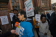 A local campaigner is interviewed by London Live TV while protesting outside Carnegie Library in Herne Hill, south London while occupiers remain inside the premises on day 5 of its occupation, 4th April 2016. The angry local community in the south London borough have occupied their important resource for learning and social hub for the weekend. After a long campaign by locals, Lambeth have gone ahead and closed the library's doors for the last time because they say, cuts to their budget mean millions must be saved.