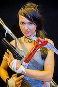 Bobbie Roberts (L - brown_owl@live.co.uk), 24 from Bristol,  comes as Lara Croft. London Film and Comic Con 2014, (LFCC), at Earls Court, London, UK.