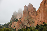 Rock formations. Garden of the Gods National Natural Landmark is run by the City of Colorado Springs in Colorado, USA. The park's outstanding geologic features of are ancient sedimentary beds of red, pink and white sandstones, conglomerates and limestone that were deposited horizontally, but have now been tilted vertically and faulted into fins by forces during uplift of the Rocky Mountains and Pikes Peak massif.