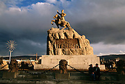 SuhBaatar Square in UlaanBaatar, Mongolia is named after the Mongolian military leader and horseman, SuhBaatar, considered a hero by Mongols for defeating the Chinese (and a Russian warlord) as commander of the Mongolian People's Revolutionary Army in the early 1900's. From coverage of revisit to Material World Project family in Mongolia, 2001.