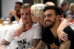 Aden Flint of Bristol City receives a kiss on the cheek from a guest as Marlon Pack smiles at the Community Foundation Quiz - Mandatory by-line: Robbie Stephenson/JMP - 19/09/2016 - FOOTBALL - Ashton Gate - Bristol, England - Bristol City Community Trust Quiz