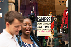Edinburgh, Scotland, UK. 10 June 2021. With few overseas tourists in Edinburgh because of Coronavirus travel restrictions, many tourist shops on the Royal Mile are closed or suffering financial difficulties. Many have put signs in windows accusing the SNP Scottish Government of not doing enough to help save jobs. Pic; Sign attacking SNP in tourist shop window on Royal Mile. Iain Masterton/Alamy Live News