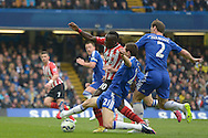 Nemanja Matic of Chelsea fouling Sadio Mane of Southampton in the penalty box for which a penalty is given. Barclays Premier league match, Chelsea v Southampton at Stamford Bridge in London on Sunday 15th March 2015.<br /> pic by John Patrick Fletcher, Andrew Orchard sports photography.