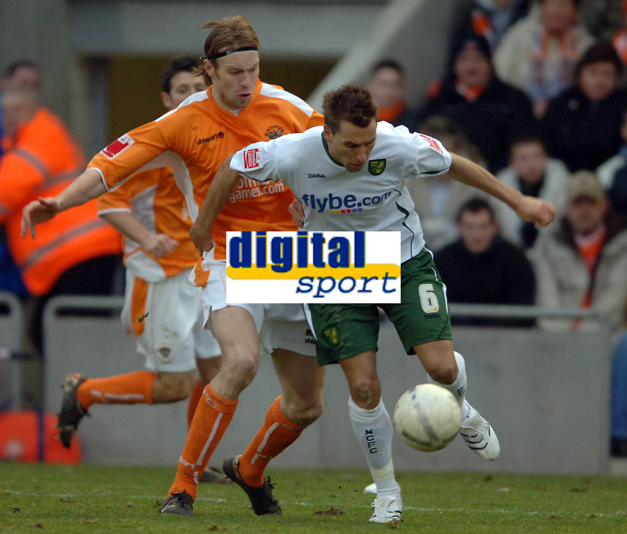 Photo: Paul Greenwood.<br />Blackpool v Norwich City. The FA Cup. 27/01/2007. Blackpool's Kaspars Gorkss (left) battles with Darren Huckerby