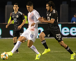 March 22, 2019 - Pablo Hernandez (22) of Chile and Rodolfo Pizarro (20) of Mexico attempt to possess the ball while Hirving Lozano (22) looks on during Mexico's 3-1 victory over Chile. (Credit Image: © Rishi Deka/ZUMA Wire)