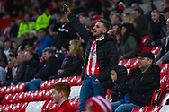 A Sunderland fan sings during the EFL Sky Bet League 1 first leg Play Off match between Sunderland and Portsmouth at the Stadium Of Light, Sunderland, England on 11 May 2019.