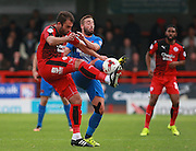 Crawley Town midfielder Simon Walton and Leyton Orient midfielder Sammy Moore tussle for possession during the Sky Bet League 2 match between Crawley Town and Leyton Orient at the Checkatrade.com Stadium, Crawley, England on 10 October 2015. Photo by Bennett Dean.