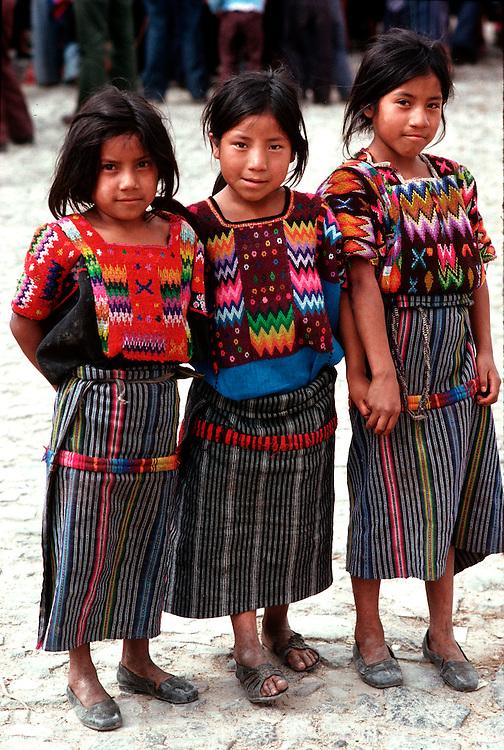 GUATEMALA, HIGHLAND MARKET Chichicastenango; Mayan girls in huipils