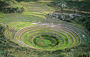 Moray, in Peru, South America, is an impressive archaeological site of terraced circular depressions, possibly an Inca agricultural experiment station. Moray is on a high plateau at 3500 m (11,500 ft) elevation in Peru just west of the village of Maras, in the Urubamba (Vilcanota) River Valley (Sacred Valley of the Incas), 50 km (31 mi) northwest of Cuzco. The Inca built Moray with a sophisticated irrigation system, possibly to study climatic effects on crops. The largest terraced pit is about 30 m (98 ft) deep, with wind and sun orientation creating a temperature difference of as much as 15 °C (27 °F) from top to bottom. Photo captured 2003.