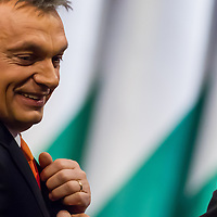 Viktor Orban (R) prime minister of Hungary smiles after finishing his speech during his annual year evaluationin Budapest, Hungary on February 22, 2013. ATTILA VOLGYI