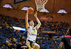 Dec 22, 2018; Morgantown, WV, USA; West Virginia Mountaineers forward Logan Routt (31) shoots a layup during the second half against the Jacksonville State Gamecocks at WVU Coliseum. Mandatory Credit: Ben Queen-USA TODAY Sports