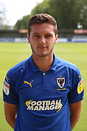 AFC Wimbledon defender Tyler Garratt (12) head and shoulders during the EFL Sky Bet League 1 match between AFC Wimbledon and Coventry City at the Cherry Red Records Stadium, Kingston, England on 11 August 2018.