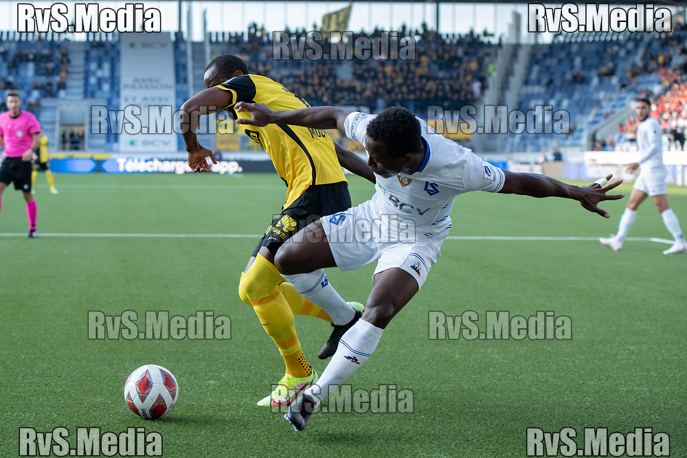 LAUSANNE, SWITZERLAND - SEPTEMBER 22: Nicolas Moumi Ngamaleu #13 of BSC Young Boys battles for the ball with Armel Junior Zohouri #24 of FC Lausanne-Sport during the Swiss Super League match between FC Lausanne-Sport and BSC Young Boys at Stade de la Tuiliere on September 22, 2021 in Lausanne, Switzerland. (Photo by Basile Barbey/RvS.Media)