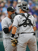 Chicago White Sox pitcher Jose Quintana, left, talks with catcher Hector Gimenez, right, after the Kansas City Royals scored two runs in the fifth inning of a baseball game at Kauffman Stadium in Kansas City, Mo., Sunday, May 5, 2013.  (AP Photo/Colin E. Braley).