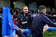 AFC Wimbledon forward James Hanson (18) warming up before the EFL Sky Bet League 1 match between AFC Wimbledon and Plymouth Argyle at the Cherry Red Records Stadium, Kingston, England on 26 December 2018.