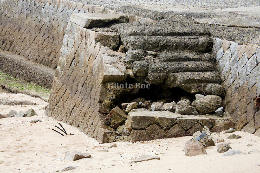 broken down stairs in sea wall
